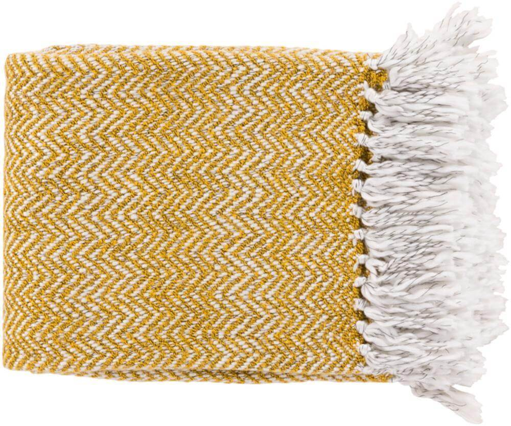 Gold and white throw blanket with white tassels for a Mid Mod bedroom