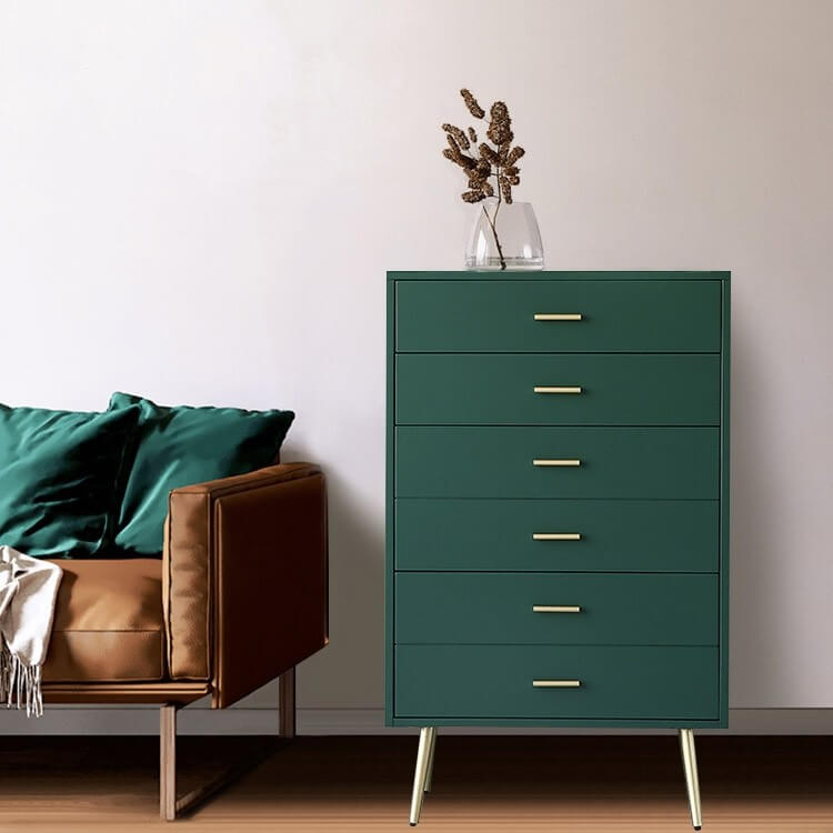 4-drawer green dresser with linear gold drawer pulls for a Mid Mod bedroom.