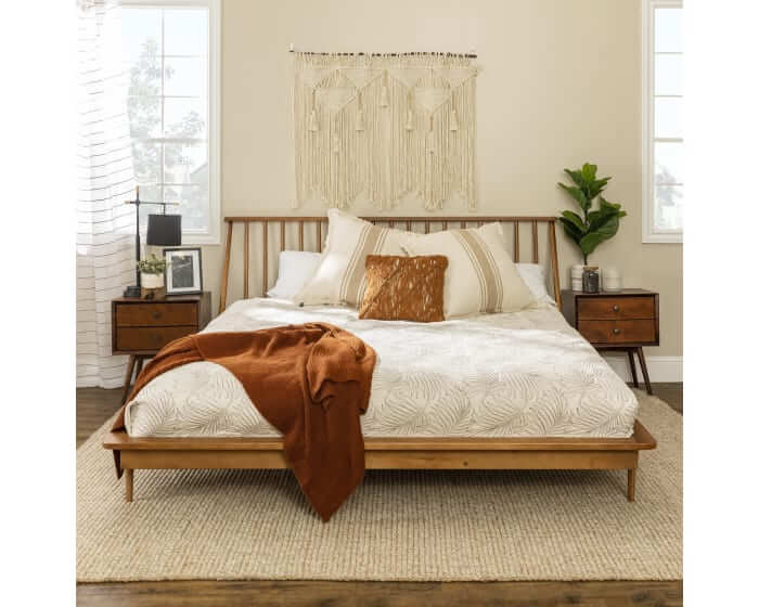 Wood spindle platform bed frame for a Mid Mod bedroom