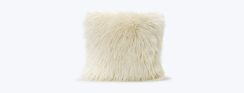 Ivory faux fur square pillow for a Mid Mod bedroom