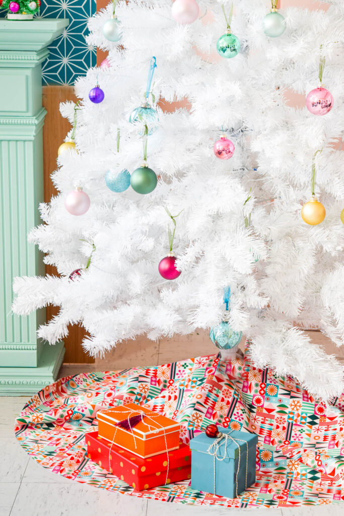 Retro holiday tree skirt with white Christmas tree and colorful ornaments