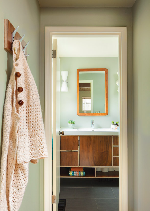 Mid century Modern bathroom with vintage-inspired light fixtures and a vanity