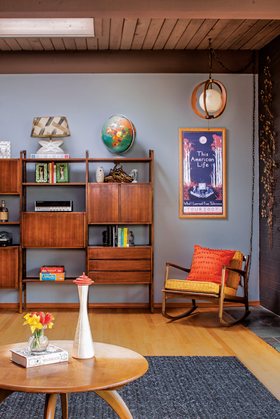 Mid century living room with modern shelving and a rocking chair.