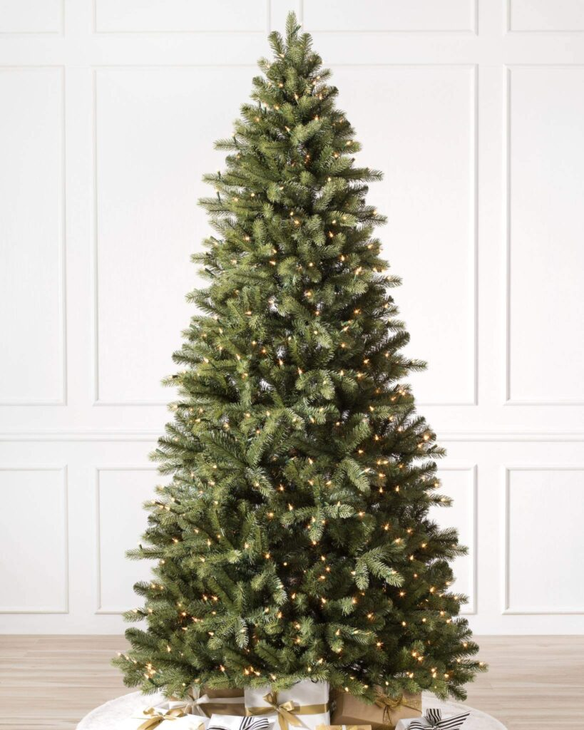 Green faux Christas tree with neutral presents underneath