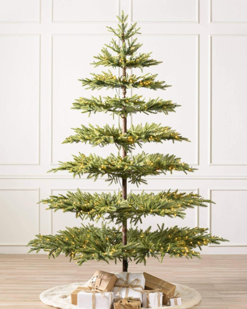Sparse faux green Christmas tree with a modern look