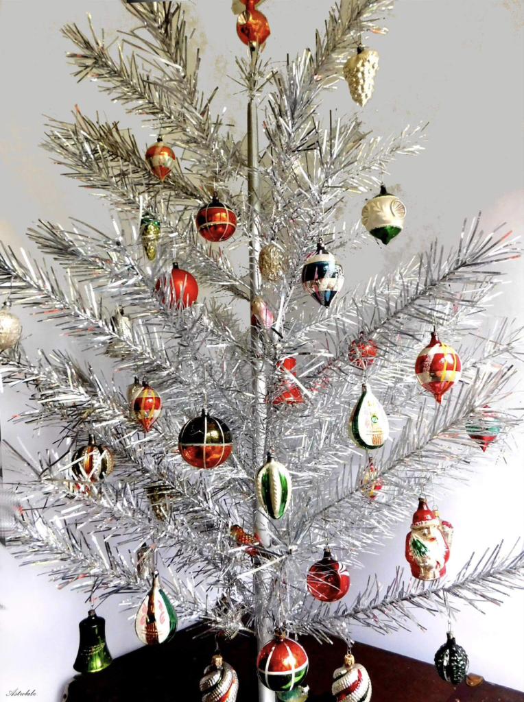 Vintage silver aluminum Christmas tree with colorful vintage ornaments