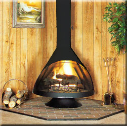 Black Malm fireplace in a room with wood plank walls and firewood.