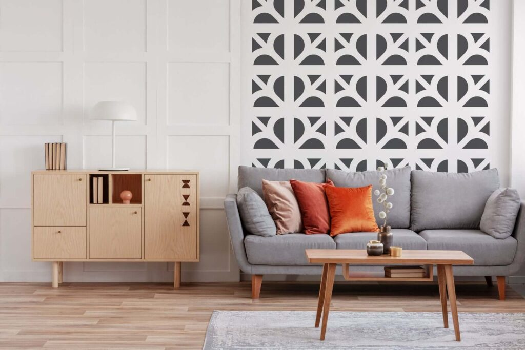 Mid Century living room with gray couch, wood coffee table and breeze block-inspired wallpaper