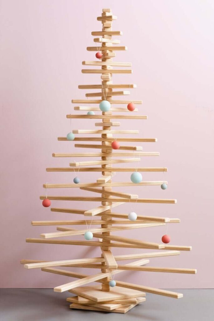 Wooden spindle Christmas tree with red and blue ornaments