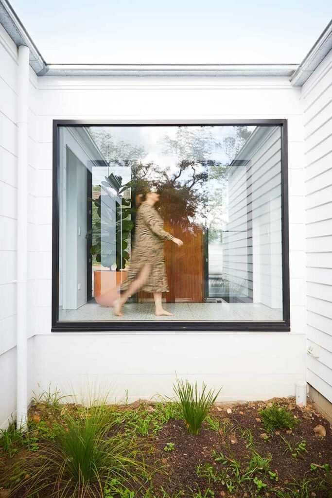 Planter alcove with large window that sees into the house