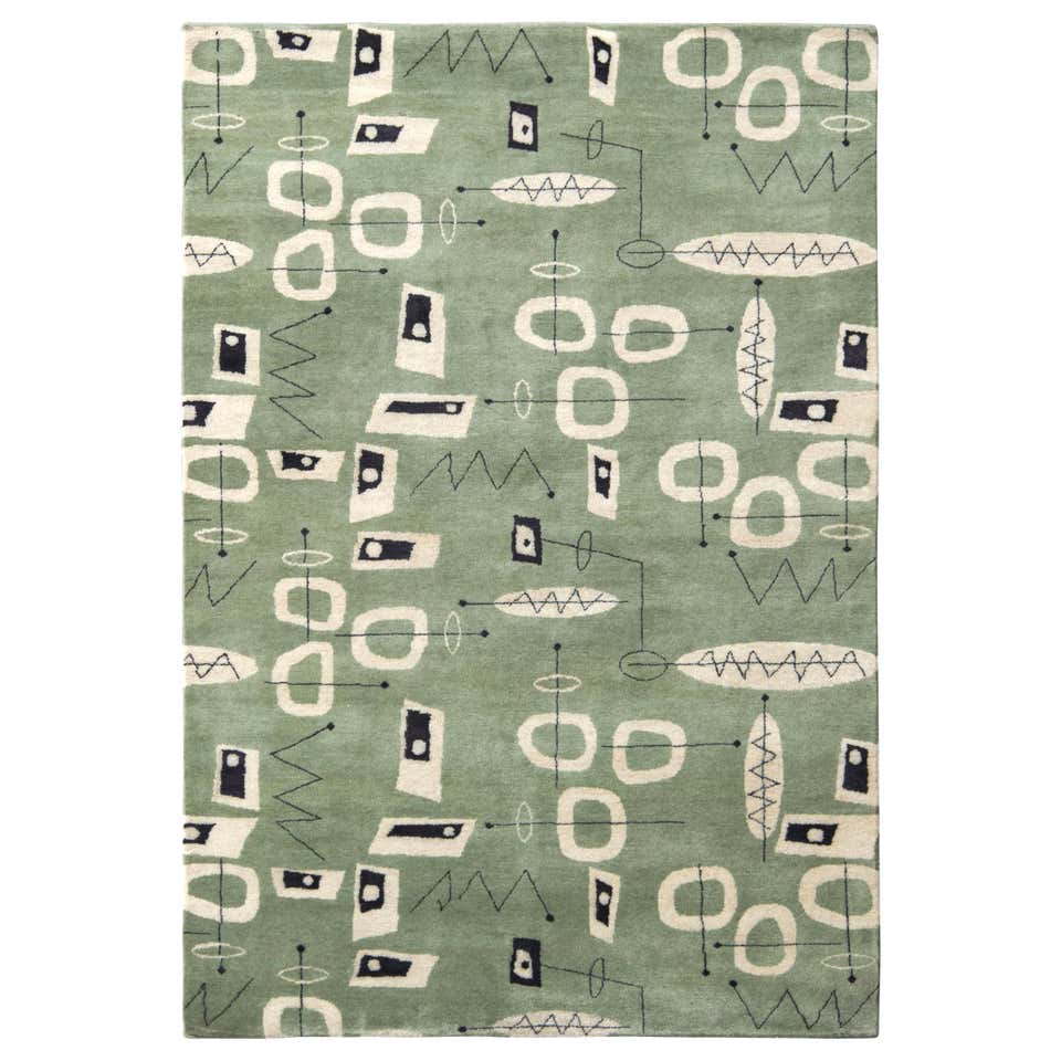 pistachio green and beige rug with mid century retro pattern