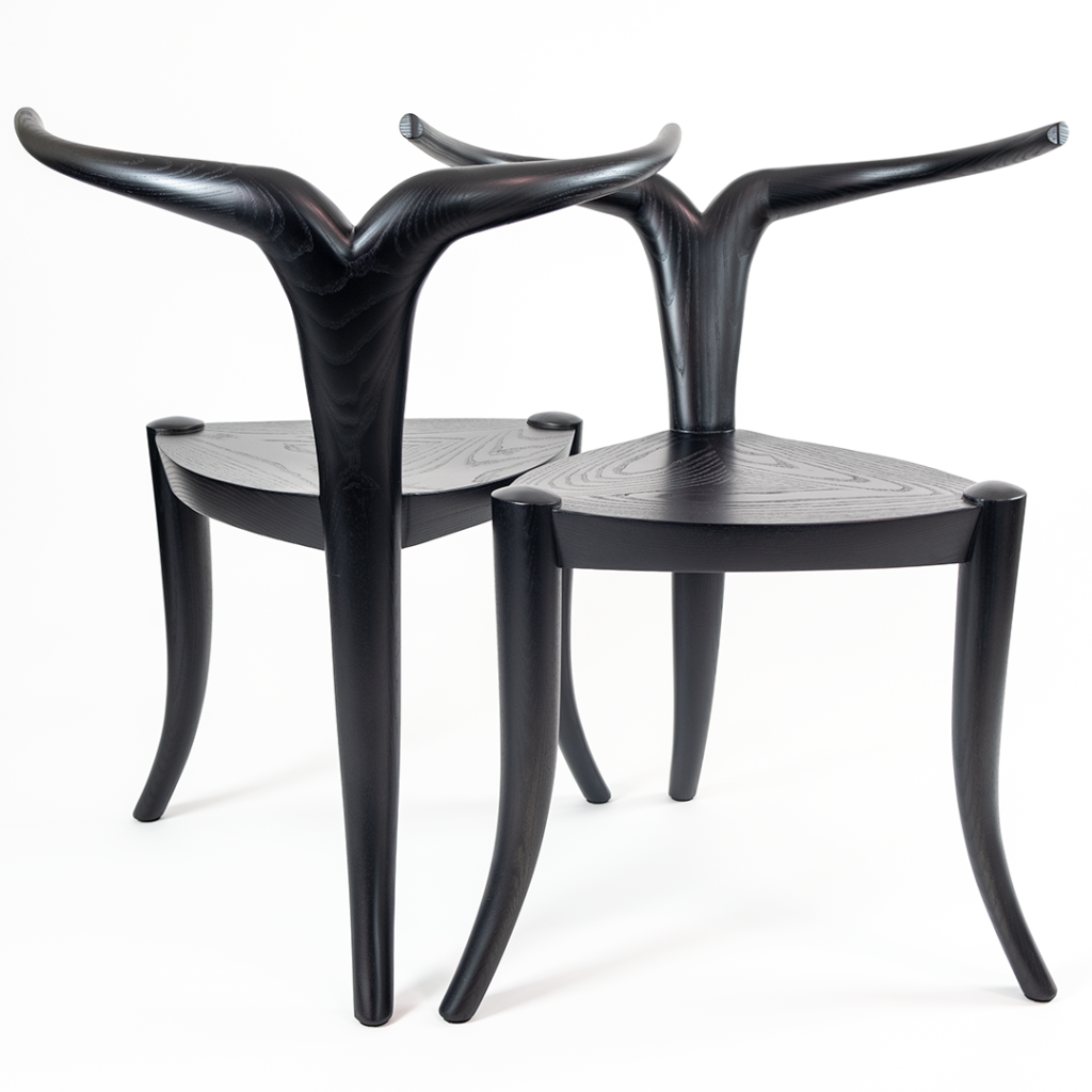 Antelope-shaped black chairs