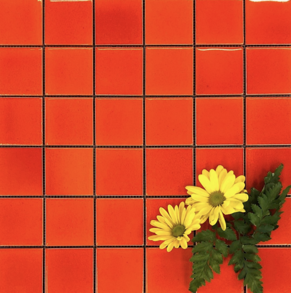 Retro red tile and yellow flowers
