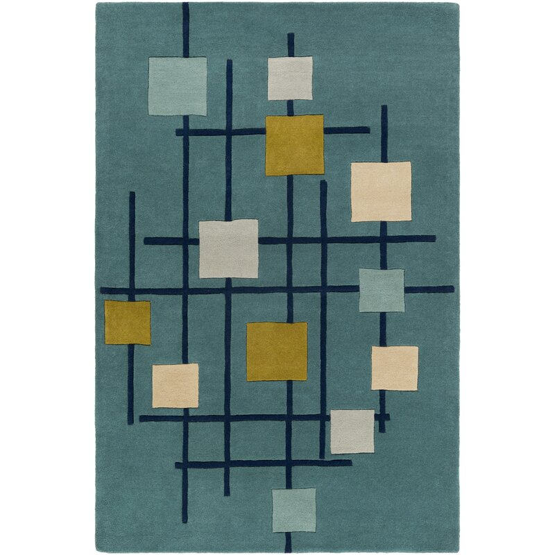 Teal blue area rug with geometric motif