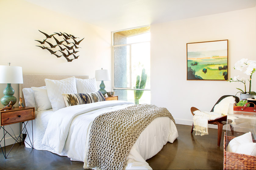 Master bedroom with bird art and neutral tones