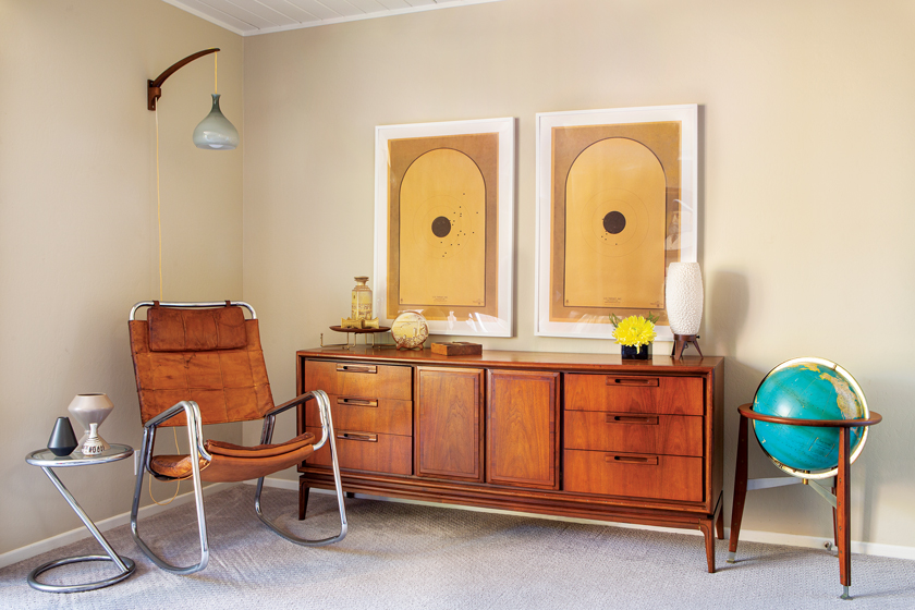 Mid Century Modern room with wood credenza, globe and wall art