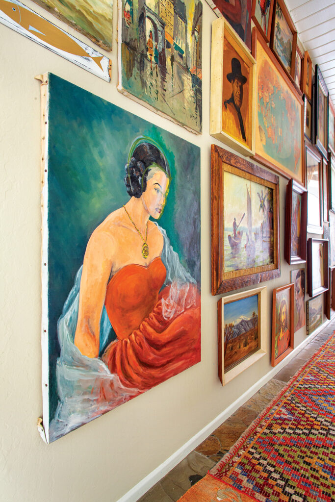 artwork from flea markets fill this hallway