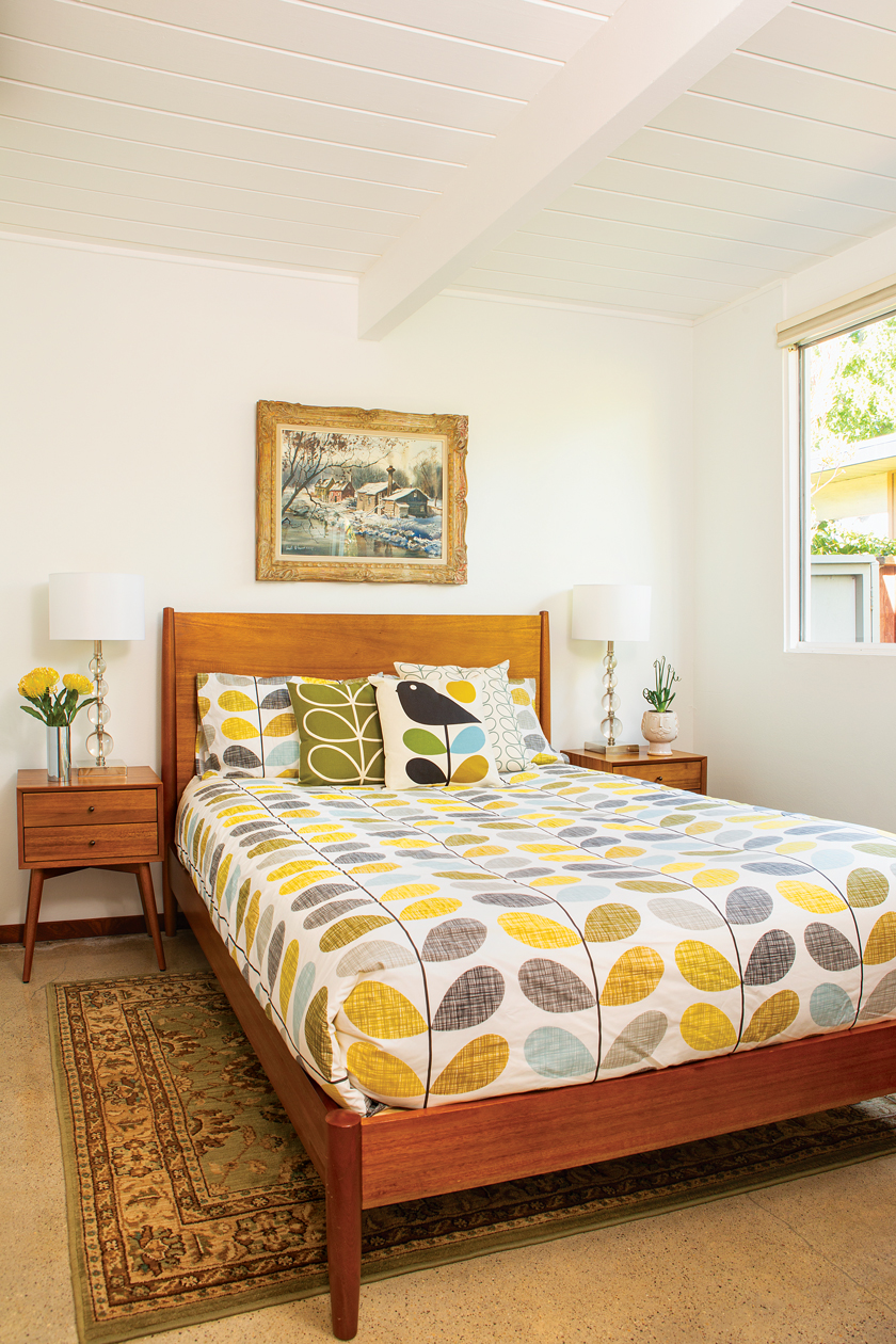 Guest room in an Eichler getaway with colorful retro bedding and MCM nightstands