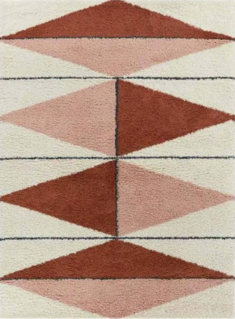 Pink and burnt orange shag area rug with black lines