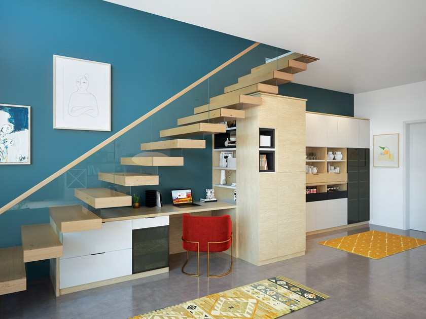 MCM home with desk area under the floating stairs