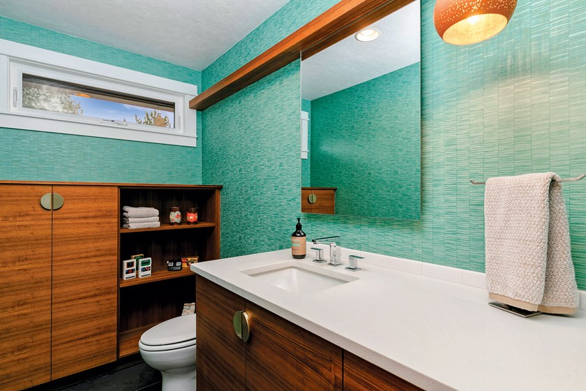 guest bathroom with teal wallpaper and MCM features