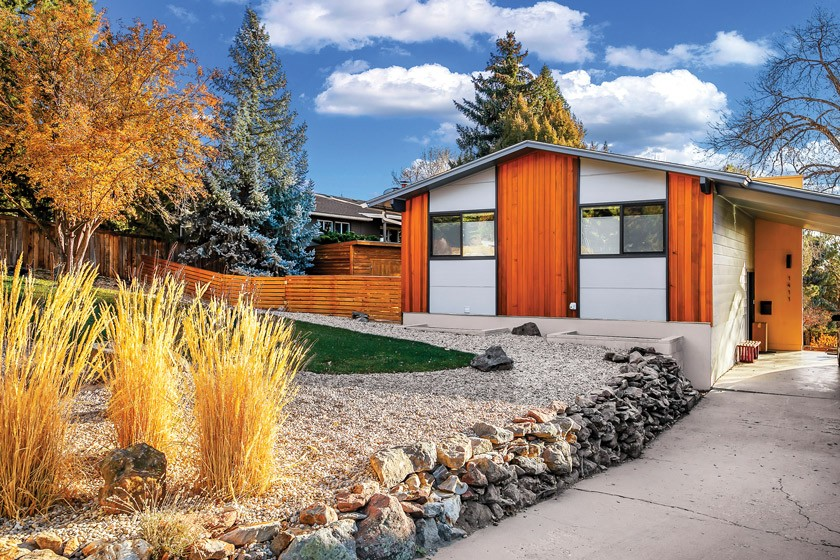 MCM home exterior with wood panels and hard landscaping