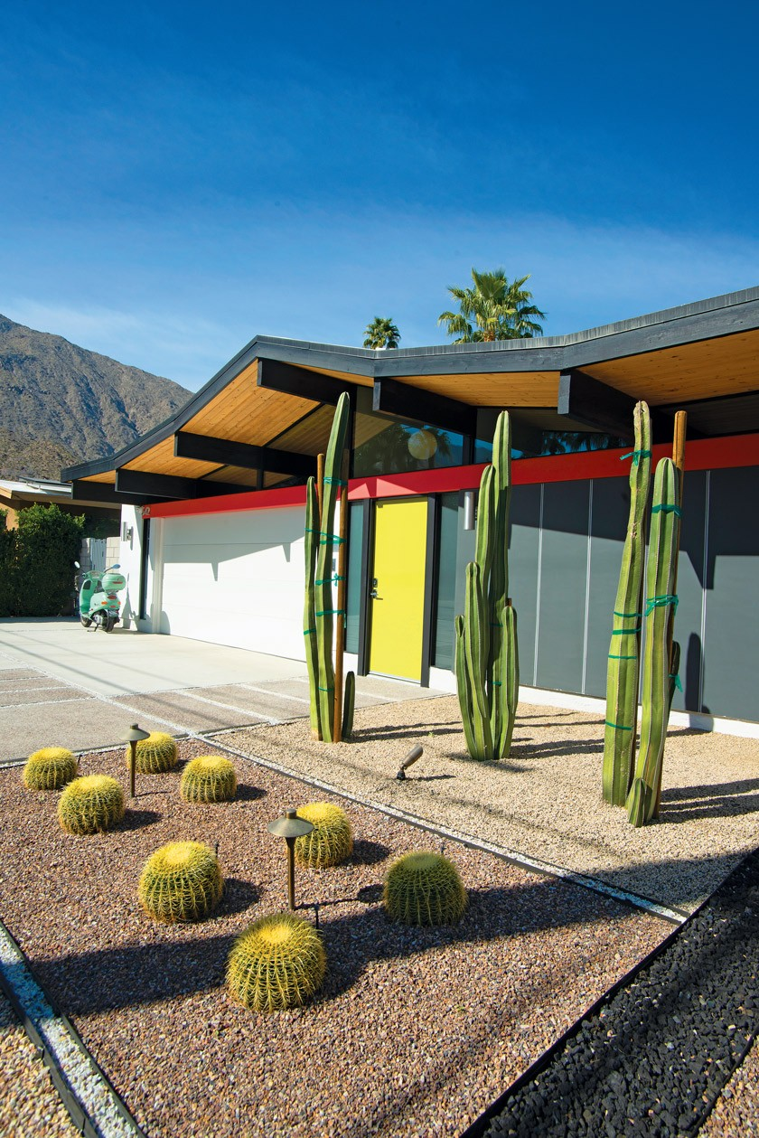 Desert Eichler exterior with cacti, a yellow door and hardscaping
