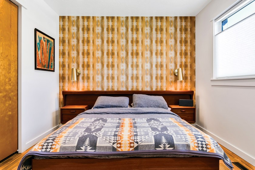 MCM master suite renovation with retro wallpaper, artwork and built-in nightstands