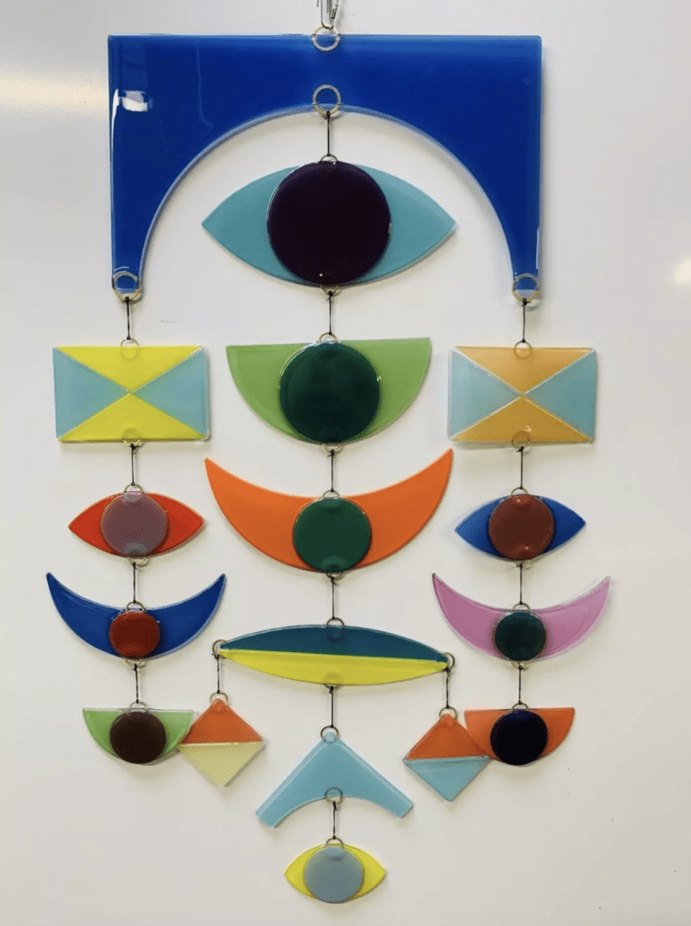 17 piece glass mobile in bright colors and repeating shapes