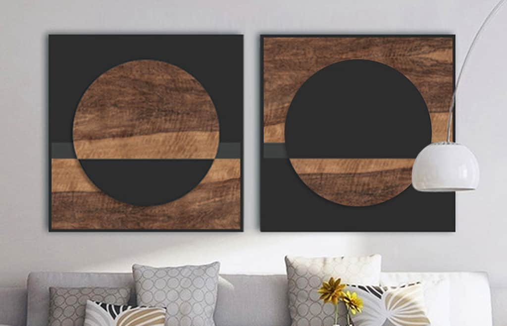 Wood sculpture art with black accents and circle and square shapes
