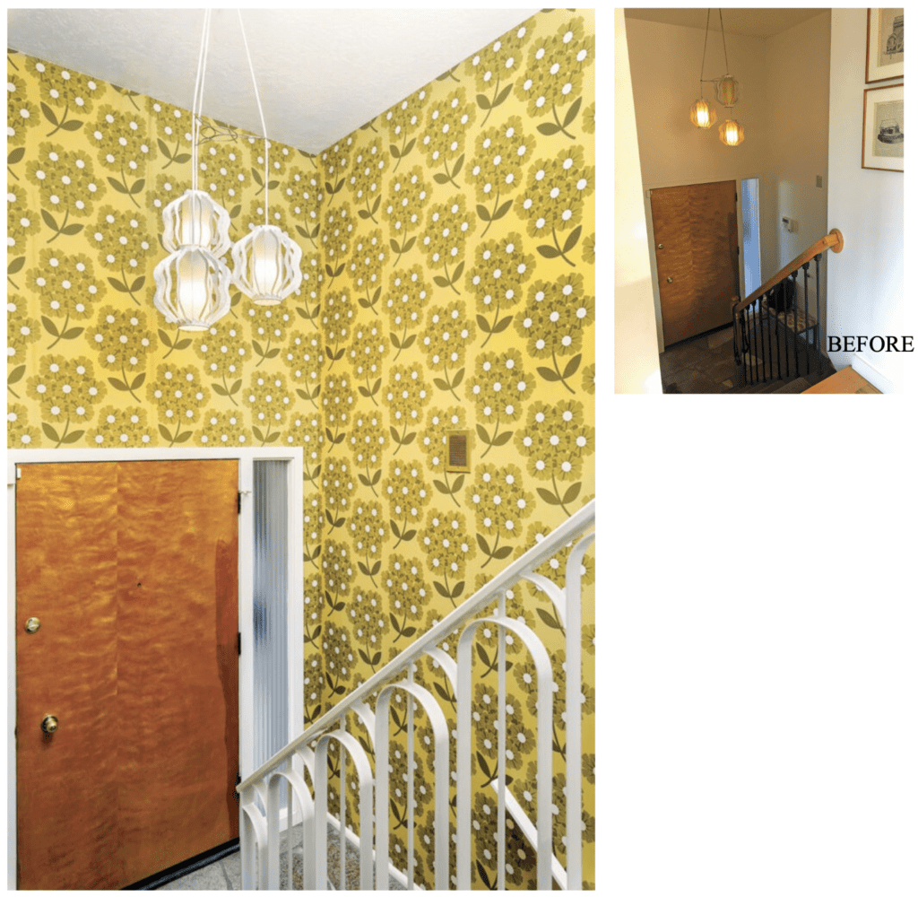 MCM entryway with yellow floral wallpaper and white staircase railing