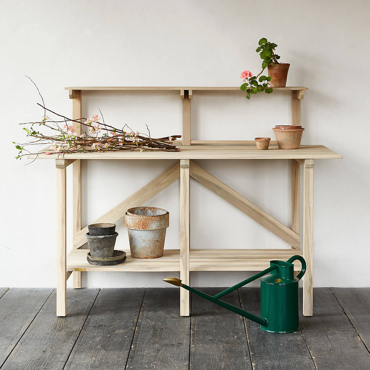 Teak potting table with clean lines
