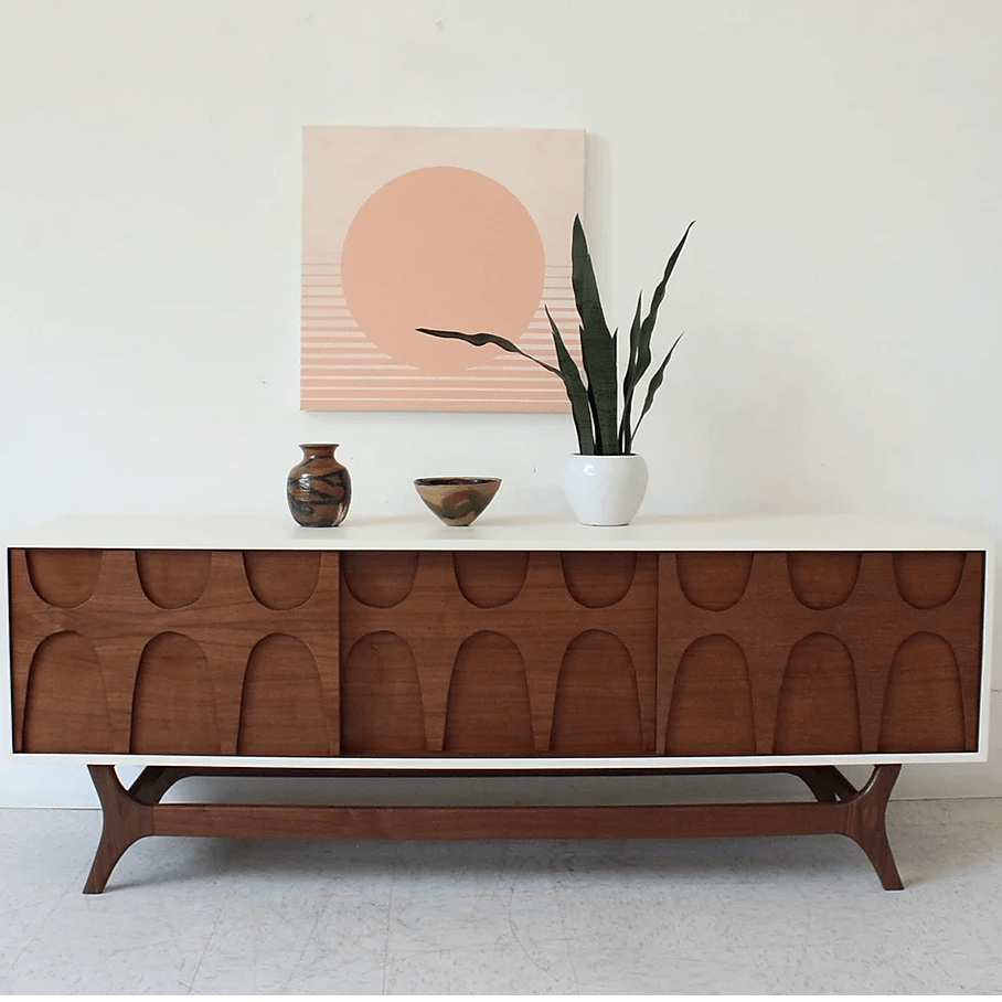 MCM credenza with white border and wood doors.