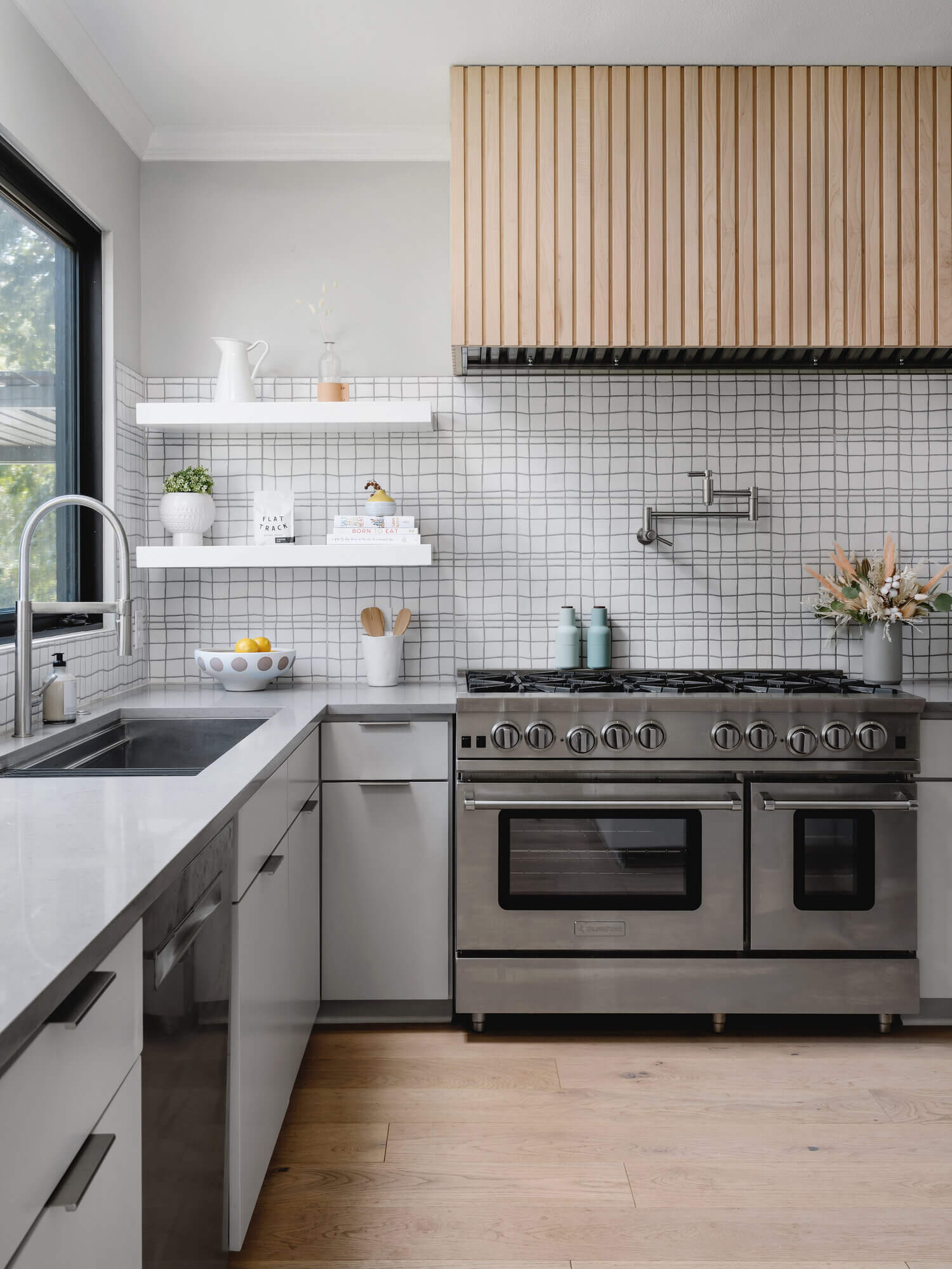 Eichler paneling is a popular MCM design element that can be used indoors like this kitchen range hood.
