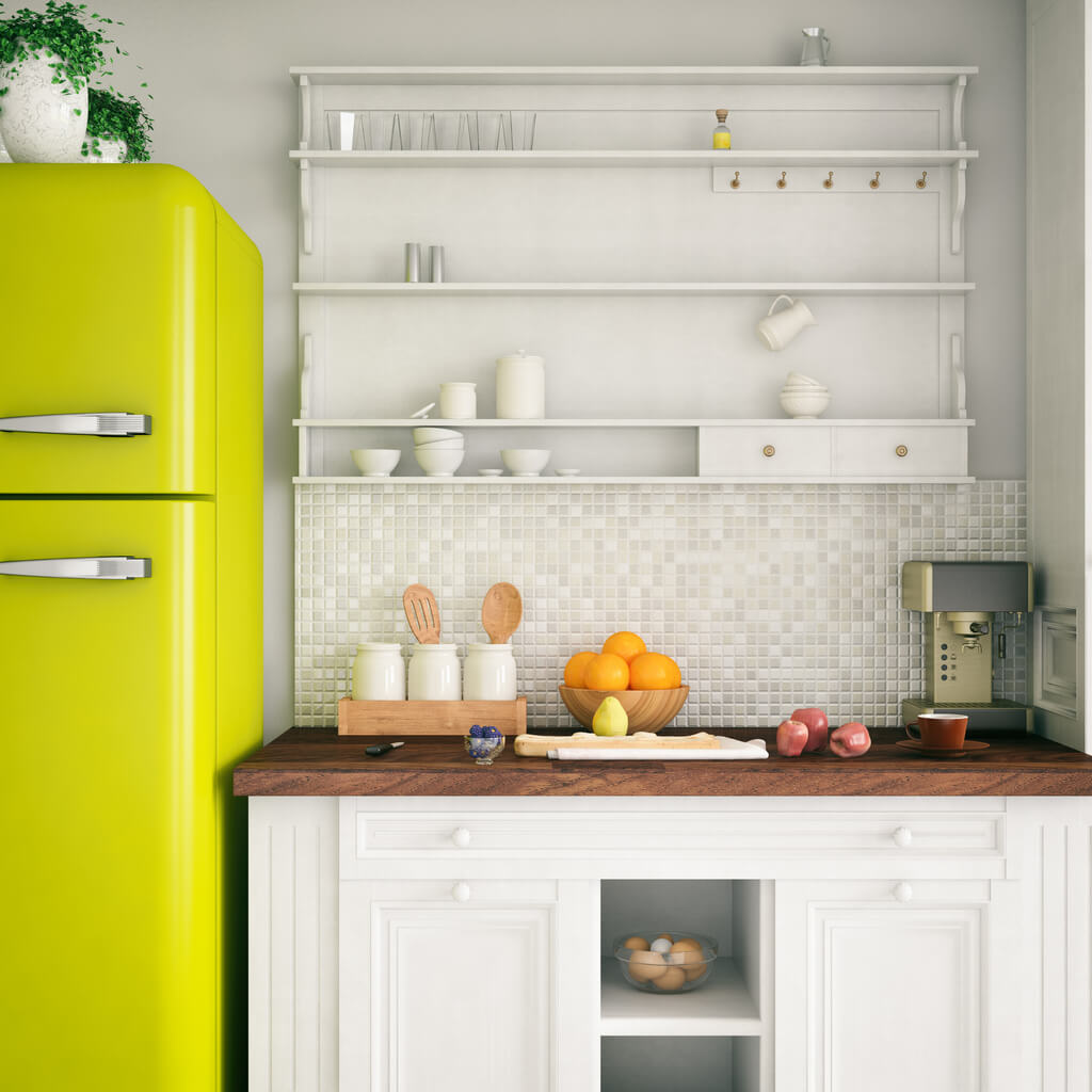 Lime green refrigerator in a white and wood kitchen.