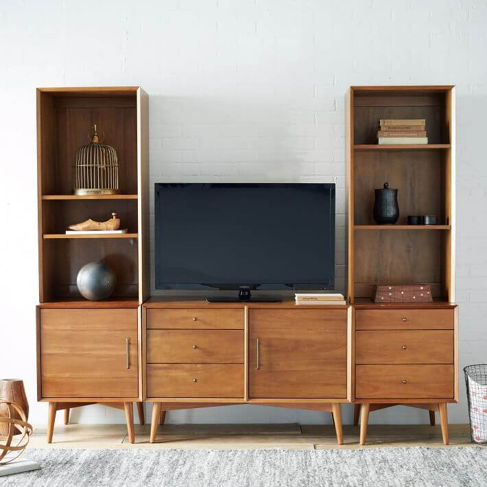 Large media console with attached bookshelves.