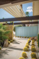 Exterior landscaping with a linear design and a T1-11 wall