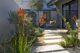 mid century modern drought-tolerant backyard with rectangular pavers